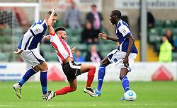 Lincoln City's Nathan Arnold is fouled by Barrow's Liam Hughes<br /> <br /> Picture: Chris Vaughan/Chris Vaughan Photography<br /> <br /> Football - Vanarama National League - Lincoln City Vs Barrow - Saturday 17th September 2016 - Sincil Bank - Lincoln<br /> <br /> Copyright © 2016 Chris Vaughan Photography. All rights reserved. Unit 11, Churchill Business Park, Bracebridge Heath, Lincoln, LN4 2FF - Telephone: 07764170783 - info@chrisvaughanphotography.co.uk - www.chrisvaughanphotography.co.uk