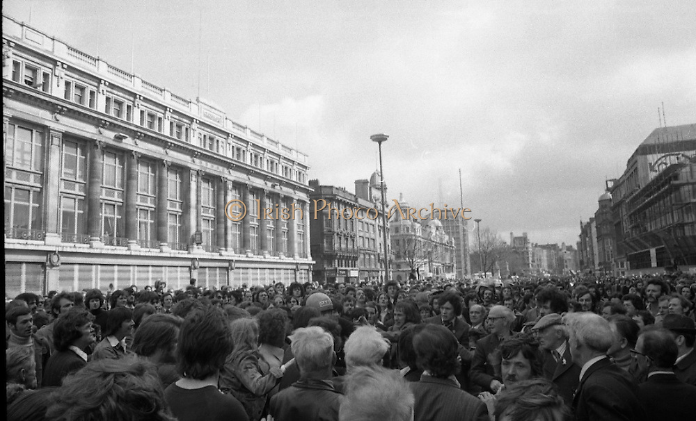 Sinn Fein (Provo) Dublin Parade.   K22..1976..25.04.1976..04.25.1976..25th April 1976..Sinn Fein held an Easter Rising Commemorative  parade..The parade started at St Stephens Green, Dublin and proceeded through the streets to the G.P.O.in O'Connell Street, the scene of the centre of the 1916 uprising..A View of the Massed crowd in O'Connell Street as a Garda is confronted by some of the throng.