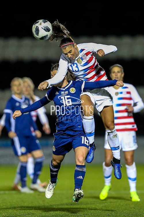 Alex Morgan (#13) of USA and Christie Murray (#16) of Scotland contest the ball in the air during the Women's International Friendly match between Scotland Women and USA at Simple Digital Arena, Paisley, Scotland on 13 November 2018.