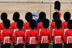 "Britain's Queen Elizabeth II (L) and US President Donald Trump (R) inspect the guard of honour formed of the Coldstream Guards during a welcome ceremony at Windsor Castle in Windsor, west of London, on July 13, 2018 on the second day of Trump's UK visit.<br /> US President Donald Trump launched an extraordinary attack on Prime Minister Theresa May's Brexit strategy, plunging the transatlantic ""special relationship"" to a new low as they prepared to meet Friday on the second day of his tumultuous trip to Britain. / AFP PHOTO / POOL / Ben STANSALL"