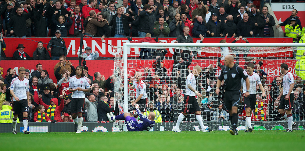 MANCHESTER, ENGLAND - Sunday, September 19, 2010: Liverpool's Christian Poulsen, Glen Johnson, goalkeeper Jose Reina and Paul Konchesky looks dejected after conceding Manchester United's opening goal during the Premiership match at Old Trafford. (Photo by David Rawcliffe/Propaganda)