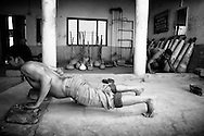 Wrestlers training in a gym (Akhara) behind Assi Ghat in Varanasi.<br /> When  I was in Varanasi there was no wrestling compititions but i was happy to spent some time watching the man practise and train.<br /> <br /> Traditional Indian wrestling is not just a sport, it's an ancient subculture where wrestlers live and train together and follow strict rules on everything, from what they can eat to what they can do in there spare time.<br /> Drinking, smoking and even sex are off limits.<br /> The focus is on living a pure life, building strength and honing their wrestling skills.<br /> Varanasi, India 2013<br /> &copy;Ingetje Tadros