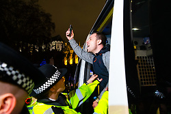 A right wing protester yells in defiance as he is placed in a police van after being arrested as Remain and Leave supporters demonstrate as MPs debate Theresa May's Brexit deal in the House of Commons, across the road in London. London, January 15 2019.
