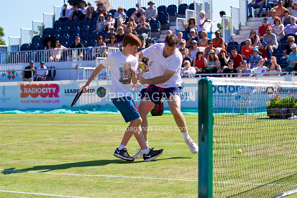 LIVERPOOL, ENGLAND - Saturday, June 17, 2017: Barry Cowan (GBR) swaps places with a ball boy during Day Three of the Liverpool Hope University International Tennis Tournament 2017 at the Liverpool Cricket Club. (Pic by David Rawcliffe/Propaganda)