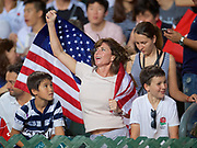A USA fan celebrates after the team scored a try in the first half  during USA v Japan match  in the Cathay Pacific/HSBC Hong Kong 7s at Hong Kong Stadium, Hong Kong, Hong Kong on 7 April 2017. Photo by Ian  Muir.*** during *** v *** in the Cathay Pacific/HSBC Hong Kong 7s at Hong Kong Stadium, Hong Kong, Hong Kong on 7 April 2017. Photo by Ian  Muir.