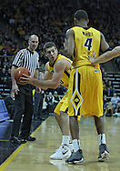January 07, 2011: Iowa Hawkeyes guard/forward Eric May (25) grabs a lose ball as Iowa Hawkeyes guard/forward Roy Devyn Marble (4) looks on during the the NCAA basketball game between the Ohio State Buckeyes and the Iowa Hawkeyes at Carver-Hawkeye Arena in Iowa City, Iowa on Saturday, January 7, 2012.