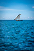 A small sail fishing boat on the sea between Stone Town and Changuu Island Zanzibar, Tanzania.  (photo by Andrew Aitchison / In pictures via Getty Images)