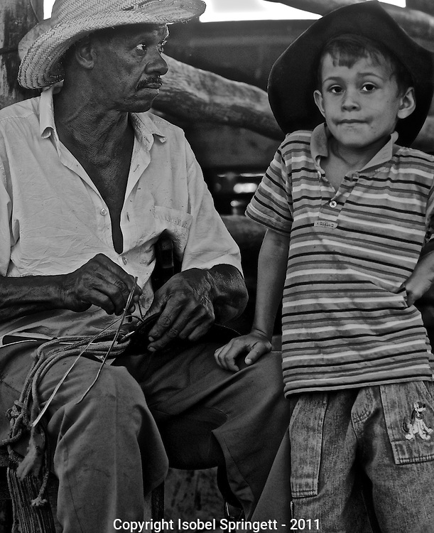 Old man and young boy, Matto Grosso, Brazil, Isobel Springett