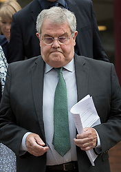 "© Licensed to London News Pictures. 03/06/2016. Woking, UK.  Des James leaves Woking Coroner's Court. A second inquest into the death of army recruit Private Cheryl James has announced its verdict today. Coroner Brian Barker QC has ruled the death of Private James was caused by a ""self-inflicted"" wound. Cheryl was found dead with a bullet wound to her head in November 1995.  Aged just 18 she was one of four young soldiers who died at the Deepcut Barracks in Surrey between 1995 and 2002, amid claims of bullying and abuse. Photo credit: Peter Macdiarmid/LNP"
