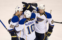 January 6, 2010; San Jose, CA, USA;  St. Louis Blues center Andy McDonald (10) is congratulated by right wing Brad Boyes (22) and goalie Evgeni Nabokov (20) during the second period against the San Jose Sharks at HP Pavilion. San Jose defeated St. Louis 2-1 in overtime. Mandatory Credit: Jason O. Watson / US PRESSWIRE