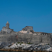 The Genoese castle and the Church of San Peitro, which was built in 1277 on exisiting six-century foundations, is on the located in Porto Venere in nothern Italy's Riveria which is nestled in the Cinque Terre region in western Italy.