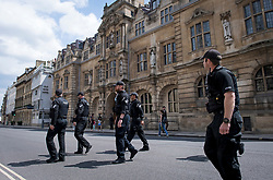 © Licensed to London News Pictures. 09/06/2020. Oxford, UK. Large numbers of police at Oriel College at Oxford University, where a demo will be held later by campaigners calling for the removal of a statue of controversial imperialist Cecil Rhodes. Black Lives Matter protesters recently pulled down a statue of slave trader Edward Colston in nearby Bristol Town centre, following the death of George Floyd in the U.S.A . Photo credit: Ben Cawthra/LNP