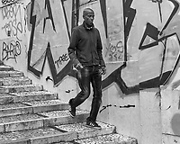 Down the Stairs. Morning Street Photography in Lisbon. Image taken with a Leica CL camera and 23 mm f/2 lens.