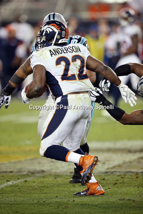 Denver Broncos running back C.J. Anderson (22) has his jersey grabbed from behind as he runs the ball for no gain in the fourth quarter during the NFL Super Bowl 50 football game against the Carolina Panthers on Sunday, Feb. 7, 2016 in Santa Clara, Calif. The Broncos won the game 24-10. (©Paul Anthony Spinelli)