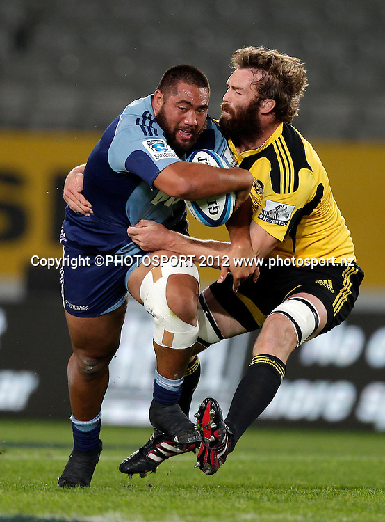 Blues prop Charlie Faumuina is tackled by Hurricanes Jason Eaton during the Super Rugby game between The Blues and The Hurricanes at Eden Park, Auckland New Zealand, Friday 23 March 2012. Photo: Simon Watts / photosport.co.nz