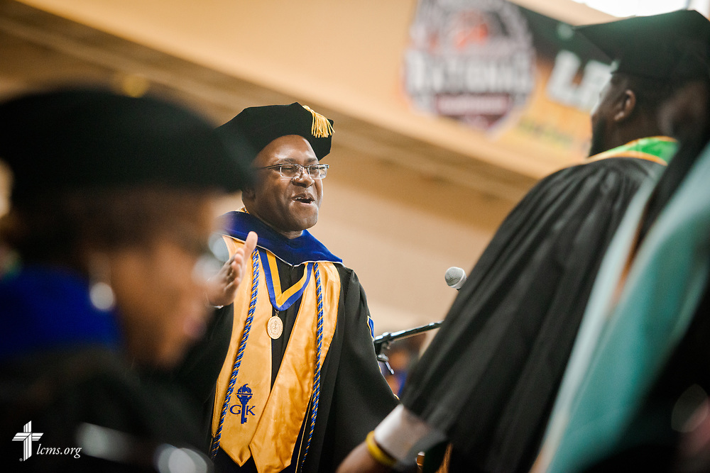 Dr. Glenn King, dean of Business and Computer Information Systems at the college, receives graduates during the 92nd and final Commencement Exercises on Saturday, April 28, 2018, in the Julius and Mary Jenkins Center at Concordia College Alabama in Selma, Ala. LCMS Communications/Erik M. Lunsford