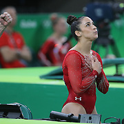 Gymnastics - Olympics: Day 6  Alexandra Raisman #395 of the United States reacts to her Floor Exercise score during her silver medal performance in the Artistic Gymnastics Women's Individual All-Around Final at the Rio Olympic Arena on August 11, 2016 in Rio de Janeiro, Brazil. (Photo by Tim Clayton/Corbis via Getty Images)