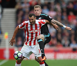 Erik Pieters of Stoke City (L) and James McClean of West Bromwich Albion in action - Mandatory by-line: Jack Phillips/JMP - 24/09/2016 - FOOTBALL - Bet365 Stadium - Stoke-on-Trent, England - Stoke City v West Bromwich Albion - Premier League