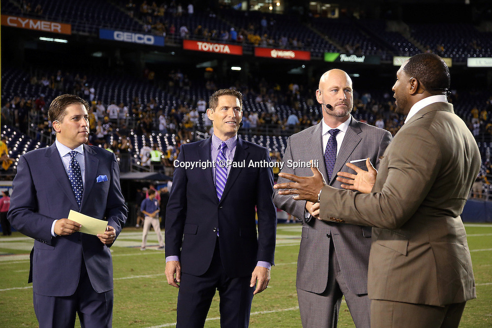 The ESPN postgame television sports analysts, including (L-R starting with second from left) Steve Young, Trent Dilfer, and Ray Lewis, talks about the game after the Pittsburgh Steelers 2015 NFL week 5 regular season football game against the San Diego Chargers on Monday, Oct. 12, 2015 in San Diego. The Steelers won the game 24-20. (©Paul Anthony Spinelli)
