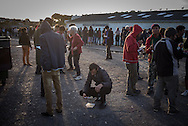 Migrants eating at a soup kitchen in Calais