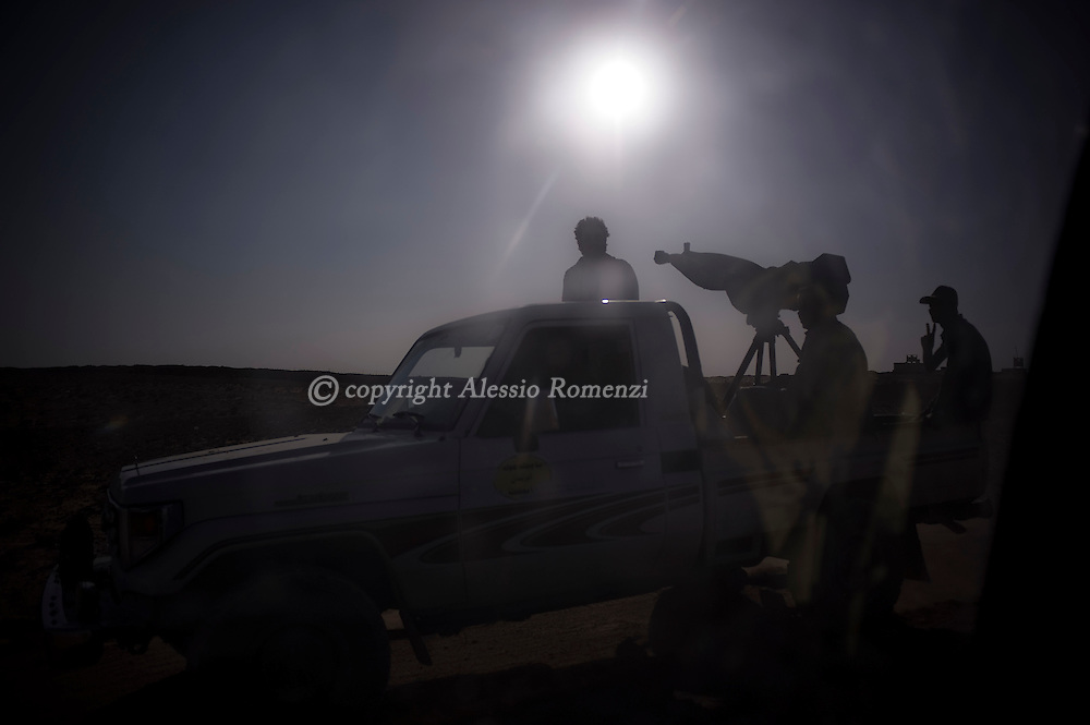 LIBYAN ARAB JAMAHIRIYA, QAA : Libyan rebels drive on a road in the rebellion western stronghold of Zentan, bombed by a NATO airstrike and consequently captured by the rebel forces. ALESSIO ROMENZI