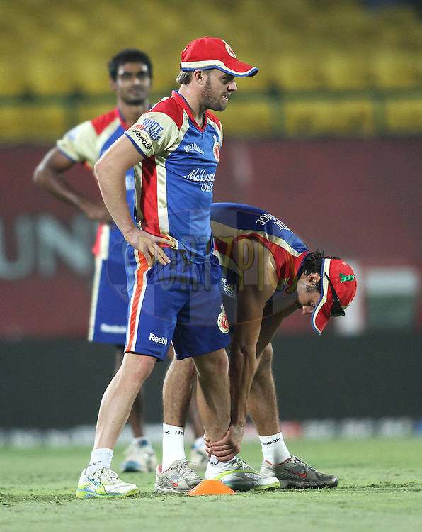 AB De Villiers of the Royal Challengers Bangalore and Johan van der Wath of the Royal Challengers Bangalore during the Royal Challengers Bangalore training session held at The HPCA Stadium in Dharamsala, Himachal Pradesh, India on the 16th May 2011..Photo by Shaun Roy/BCCI/SPORTZPICS