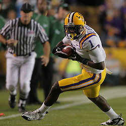 Oct 31, 2009; Baton Rouge, LA, USA;LSU Tigers wide receiver Brandon LaFell (1) runs away from Tulane Green Wave cornerback Phillip Davis (13) during the first quarter at Tiger Stadium. LSU defeated Tulane 42-0. Mandatory Credit: Derick E. Hingle