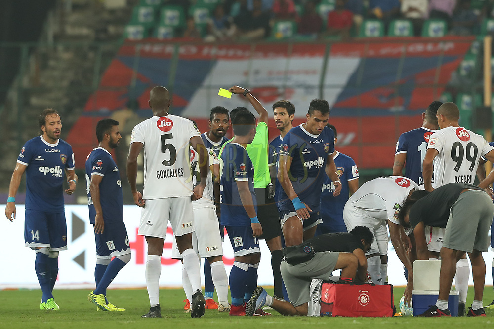 Dhanpal Ganesh of Chennaiyin FC receives a yellow card from the referee during match 6 of the Hero Indian Super League between Chennaiyin FC and NorthEast United FC held at the Jawaharlal Nehru Stadium, Chennai, India on the 23rd November 2017<br /> <br /> Photo by: Ron Gaunt / ISL / SPORTZPICS