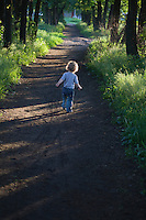 Child on country path