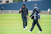 Tony Finau acknowledges the applause as he sinks a birdie putt on the first green during the final round of the Alfred Dunhill Links Championship European Tour at St Andrews, West Sands, Scotland on 29 September 2019.