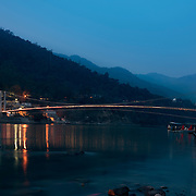 The lights of Rishikesh illuminate the Ganges River at Rishikesh, Uttarakhand, India.