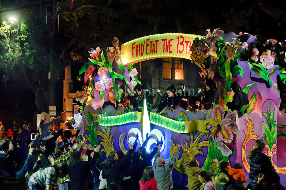 13 Feb 2015. New Orleans, Louisiana.<br /> Mardi Gras. Krewe D'Etat makes its way along Magazine Street. Frid'etat the 13th.<br /> Photo; Charlie Varley/varleypix.com