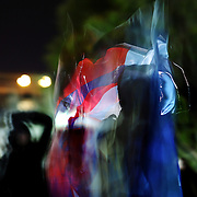 A man waves a Flag with an image of Obama while celebrating in front of the White House in Washington DC after Barack Obama was announced the winner of the 2012 presidential elections. (motion-blur intentional)