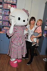 DAISY BATES and her son WOODY at a Hello Kitty Event at Liberty to lauch their collection of Hello Kitty products at Liberty, Great Marlborough Street, London on 25th September 2011.