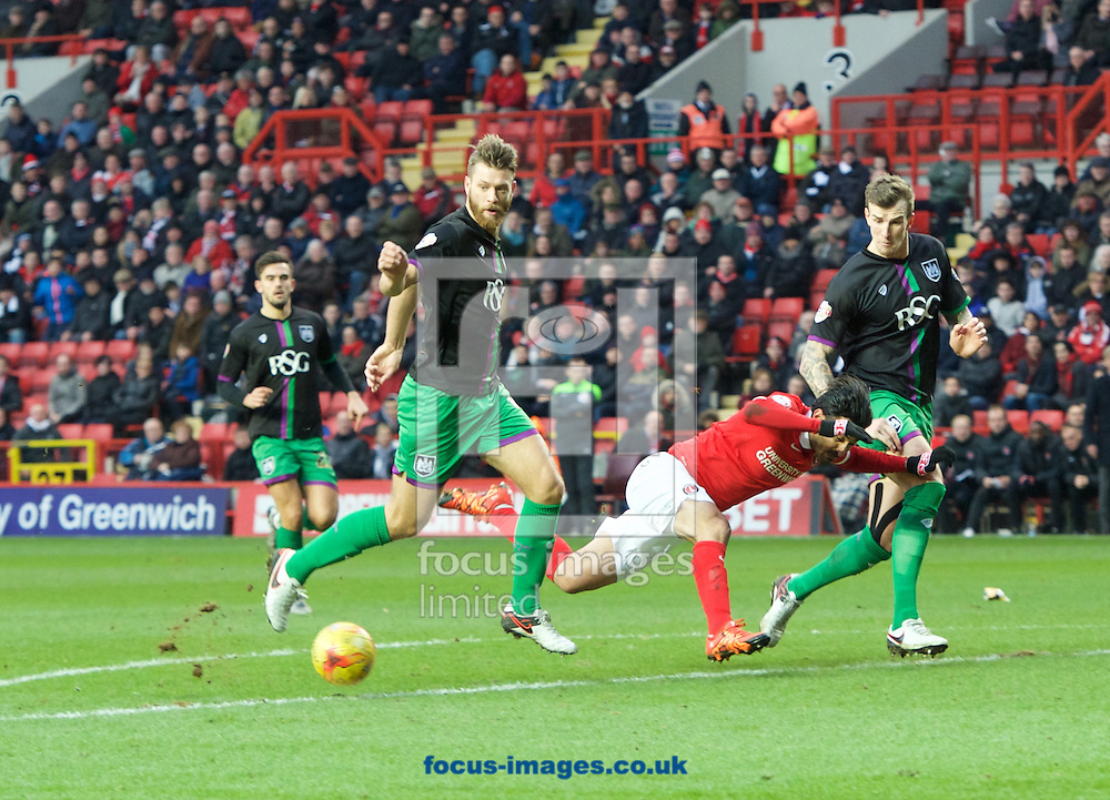 Jordan Cousins of Charlton Athletic is brought down by Nathan Baker of Bristol City on the edge of the penalty box during the Sky Bet Championship match at The Valley, London<br /> Picture by Alan Stanford/Focus Images Ltd +44 7915 056117<br /> 06/02/2016