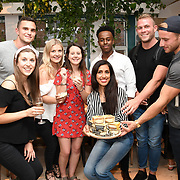 The Oppo teams at the party to launch its new Madagascan Vanilla, Sicilian Lemon and Raspberry Cheesecakes, served with Skinny Prosecco at Farm Girls Café, 1 Carnaby Street, Soho, London, UK on July 18 2018.