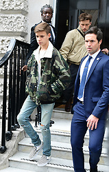 Romeo Beckham and his brother Brooklyn (rear right) leave after attending the Victoria Beckham London Fashion Week SS19 show in Dover Street, London.