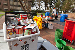 Garbology on Red Square, where grash from different locations is sorted to determine how much is recycleable or compostable at PLU on Tuesday, March 17, 2015. (Photo: John Froschauer/PLU)