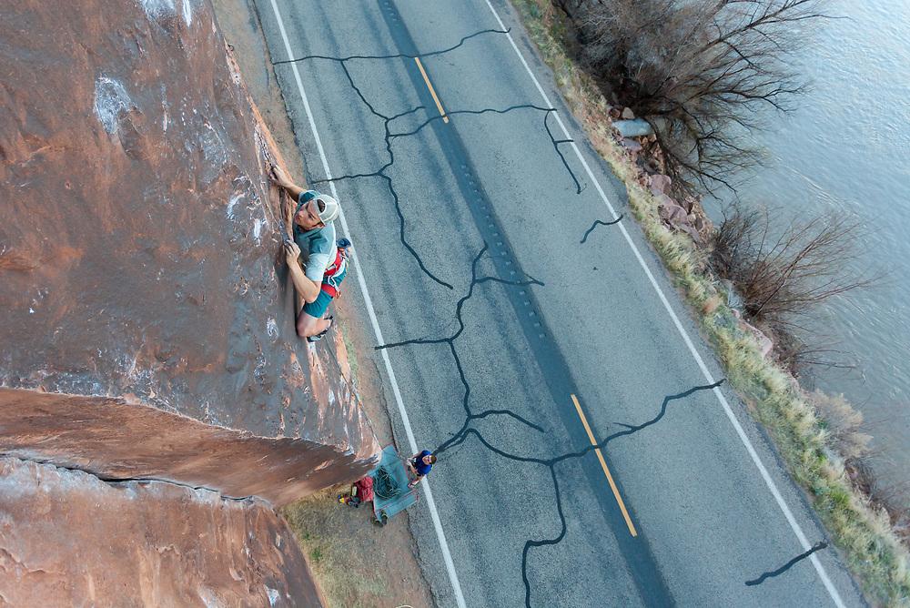 Pat Lindsay climbing Fernando, 5.11 at Wallstreet in Moab