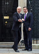 © Licensed to London News Pictures. 05/02/2013. Westminster, UK Joe Biden jokes with the media about th cold temperature. American Vice President Joe Biden (L) leaves number 10 Downing Street with UK Prime Minister, David Cameron,  after meetings today 5th February 2013. Photo credit : Stephen Simpson/LNP