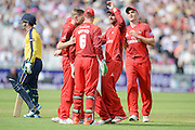 Will Smith walks off as Lancashire celebrate during the NatWest T20 Blast Semi Final match between Hampshire County Cricket Club and Lancashire County Cricket Club at Edgbaston, Birmingham, United Kingdom on 29 August 2015. Photo by David Vokes.