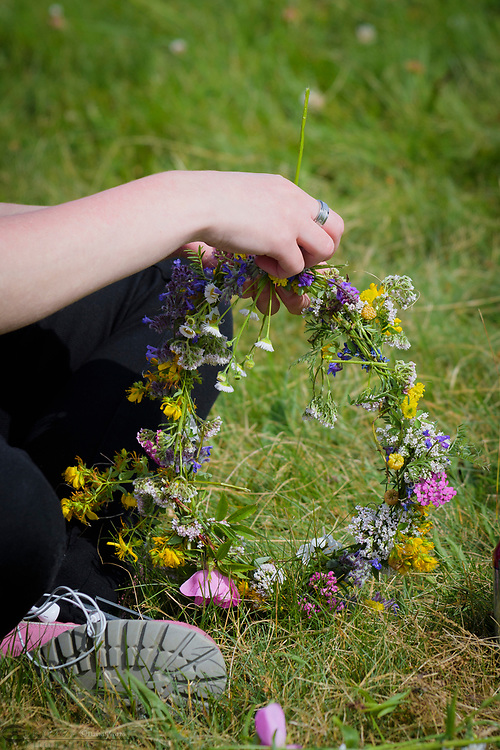Weaving together wildflowers to create a tiara.
