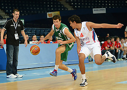 Nejc Zupan of Slovenia vs Stefan Peno of Serbia during basketball match between National teams of Serbia and Slovenia in Division A of U16 Men European Championship Lithuania 2012, on July 21, 2012 in Panevezys, Lithuania. (Photo by Robertas Dackus / Sportida.com)