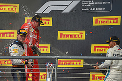 October 21, 2018 - Austin, TX, U.S. - AUSTIN, TX - OCTOBER 21: Red Bull Racing driver Max Verstappen (33) of Netherlands and Mercedes driver Lewis Hamilton (44) of Great Britain spray champagne on Ferrari driver Kimi Raikkonen (7) of Finland following the F1 United States Grand Prix on October 21, 2018, at Circuit of the Americas in Austin, TX. (Photo by Ken Murray/Icon Sportswire) (Credit Image: © Ken Murray/Icon SMI via ZUMA Press)
