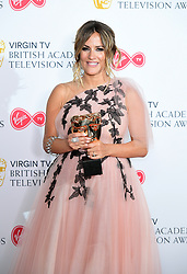 Caroline Flack with the reality and constructed factual award on behalf of Love Island in the press room at the Virgin TV British Academy Television Awards 2018 held at the Royal Festival Hall, Southbank Centre, London.