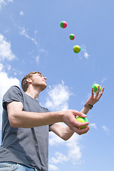 "Juggler throwing balls into the air at the Nottingham University Student Union ""Sounds on the Downs"" Green Fields Festival; part of Green Week 2008,"