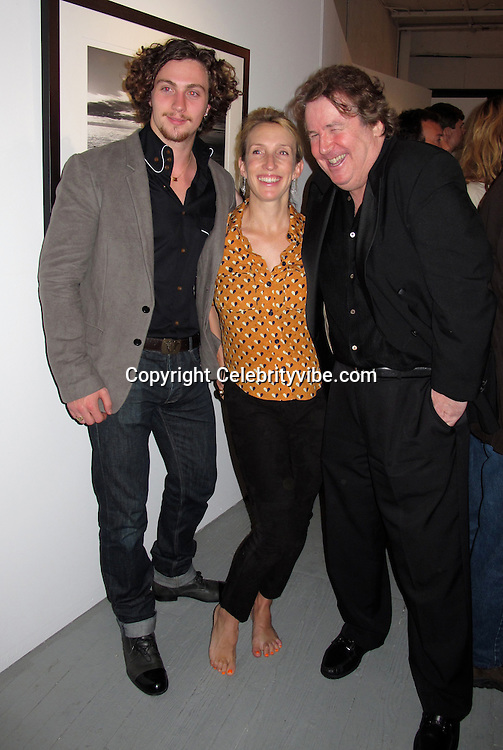 "Actor Aaron Johnson and Director Sam Taylor-Wood..""Timeless"" by Julian Lennon, Photography Exhibit Opening of John Lennon and Bono's Photographs..Morrison Hotel Gallery..New York, NY, USA..Thursday, September 16, 2010..Photo By iSnaper.com/ CelebrityVibe.com..To license this image please call (212) 410 5354; or Email: CelebrityVibe@gmail.com ; .website: www.CelebrityVibe.com."