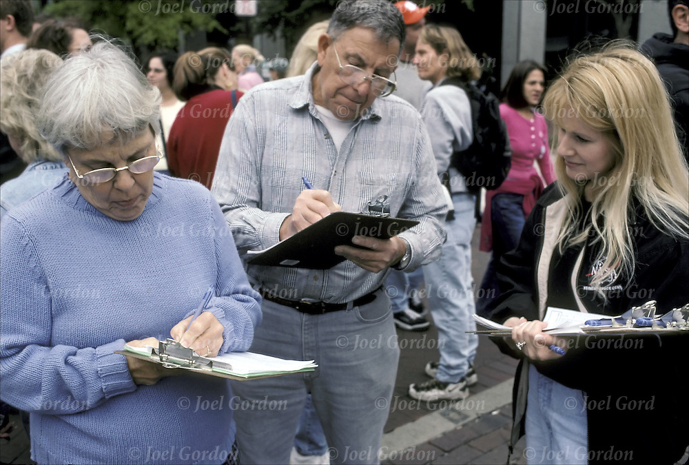 Street survey, cross section of population, people at street fair, older couple answering, filling out questionnaire, Winter Park, FL