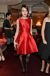 ELLA CATLIFF at a dinner hosted by fashion label Kate Spade NY held at George, 87-88 Mount Street, London on 19th November 2014.