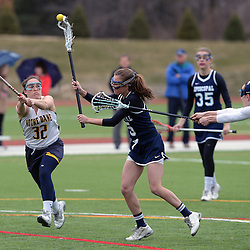 Staff photos by Tom Kelly IV<br /> Episcopal's Jane Crager (5) shoots and scores through the reaching sticks of Notre Dame's Kaitlyn May (32) and Caroline McHugh (8) during the Episcopal Academy at Notre Dame girls lacrosse game on Tuesday afternoon, March 31, 2015.